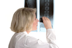 Radiologist with magnifying glass and x-rays Stock Image