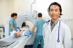 Radiologist With Nurses Preparing Patient For CT Royalty Free Stock Photo