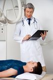 Radiologist With Patient At Clinic Stock Images