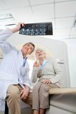 Radiologist With Patient Looking At X-ray Royalty Free Stock Photos