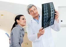 Radiologist And Patient Looking At X-ray Stock Photography