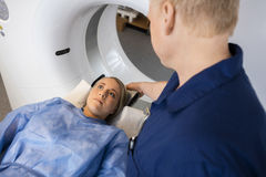 Radiologist Preparing Female Patient For MRI Scan In Hospital Royalty Free Stock Image