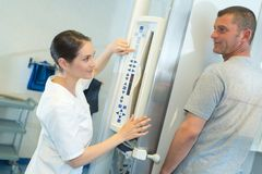 Radiologist setting up equipment for scan. Radiologist stock photo