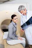 Radiologist Showing X-ray To Female Patient Stock Image