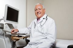 Radiologist Sitting By Ultrasonic Machine Stock Photos