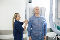 Radiologist Taking Xray Of Male Patient In Hospital stock images