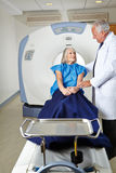 Radiologist talking to senior woman at MRI Royalty Free Stock Photography