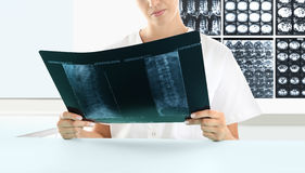 Radiologist woman checking xray, healthcare, medical concept Royalty Free Stock Image