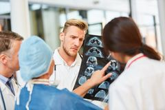 Radiologists analyze findings on MRI sectional image stock photos