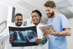Radiologists With Chest X-ray And Digital Tablet In Hospital Royalty Free Stock Images