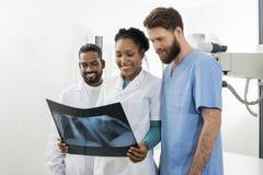 Radiologists Examining Chest X-ray In Examination Room Royalty Free Stock Photos