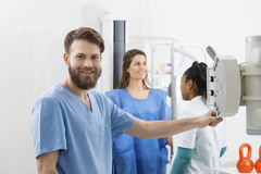 Radiologists Preparing For X-ray Over Female Patient In Hospital Royalty Free Stock Photo