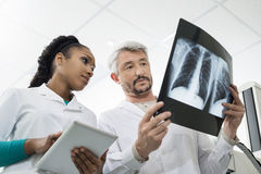 Radiologists With X-ray Using Digital Tablet In Hospital Stock Images