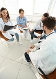 Radiologists and a surgeon discussing a radiograph of a patient Royalty Free Stock Photos