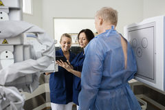 Radiologists Using Tablet Computer By Patient Royalty Free Stock Image