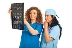 Radiologists women examine MRI Stock Photos