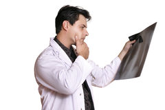 Radiology. A man reviews patient x-ray looking for signs of disease, tumour, fracture, etc Stock Photo