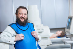 Radiology specialist portrait. Smiling male radiologist in prote Royalty Free Stock Photo
