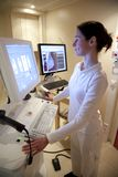 Radiology technician performs mammography test Royalty Free Stock Image