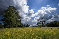 Radiotelescope in a meadow of. A radiotelescope, part of the Synthesis Radio Telescope Array at Westerbork, the Netherlands stock photos