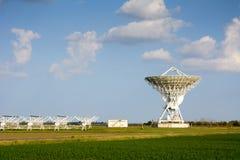 Radiotelescope: parabolic antenna and linear array antenna Stock Images