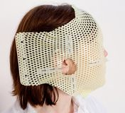 Radiotherapy Mask. Female patient wearing a custom made Thermoplastic Radiotherapy Mask Stock Photo