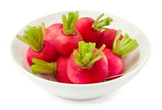 Radish in a bowl. Against white background Royalty Free Stock Images