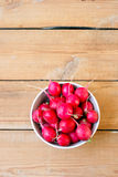 Radish in a bowl. On the wooden table Royalty Free Stock Photo