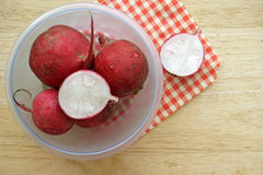 Radish in bowl on wooden table. With tablecloth Stock Image