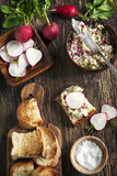 Radish butter. With toast on wooden table Royalty Free Stock Photography
