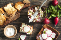 Radish butter. And toasts on wooden table. Top view Stock Photography