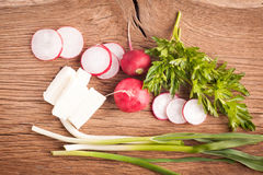 Radish, cheese and onion. Radish, sheese and onion on old wooden table. Rustic style. Vegetarian food Stock Photo