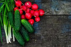 Radish cucumbers and green onion on wooden table. Top view Royalty Free Stock Photography