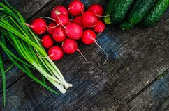 Radish cucumbers and green onion on wooden table. Top view Stock Photos