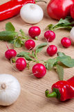 Radish. Fresh radishes with other vegetables on wooden background Stock Images