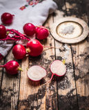 Radish half with salt on rustic wooden background Royalty Free Stock Photo