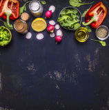 Radish lemon arugula lettuce pepper salt seasoning various stacked horizontally border banner fruits  vegetables space text Royalty Free Stock Photos