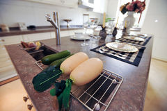 Radish in a Modern design kitchen white cupboard Stock Photo