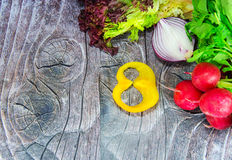 Radish with onion and pepper for Woman's day. Vegetables and pepper in the shape of digit 8 for Woman's day stock photos