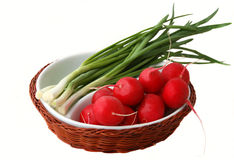 Radish onion on a white plate. Radish, onion on a white plate isolated on white Royalty Free Stock Images