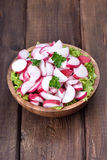 Radish salad in bowl Stock Photo