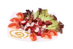 Radish salad with grilled sausages and tomatoes. Royalty Free Stock Photo