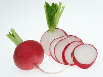 Radish. Sliced ​​fresh vegetables on white background Stock Image