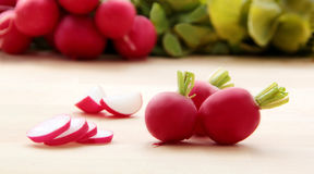 Radish. Slices and pieces of radishes. Wooden background. Closeup view Stock Photo