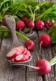 Radish. Some fresh ripe radishes on old wooden table Royalty Free Stock Photos