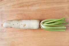 Radish vegetable. On a wooden background Royalty Free Stock Photo