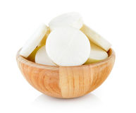 Radish in wood bowl on white background. Radish in wood bowl on a white background Royalty Free Stock Image