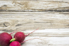 Radish on a wooden background. Rustic background Royalty Free Stock Images