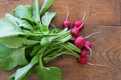 Radish on wooden table Stock Photography