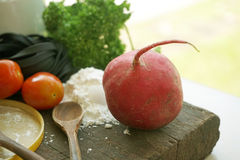 Radish on wooden table. With parsley Royalty Free Stock Photos
